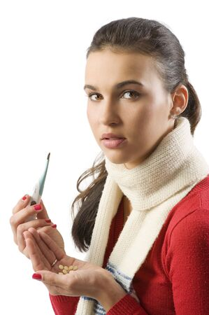 cute brunette in red pullover and white scarf with thermometer and pills looking sick photo