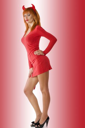 sexy redhead devil with red mini dress and black heels photo