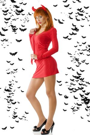sexy redhead devil with red mini dress black heels and horns photo