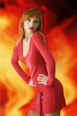 red haired woman with a red mini dress and horns like a demon photo