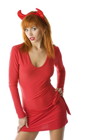 redhead: young woman in halloween costume with red dress and horns like a demon