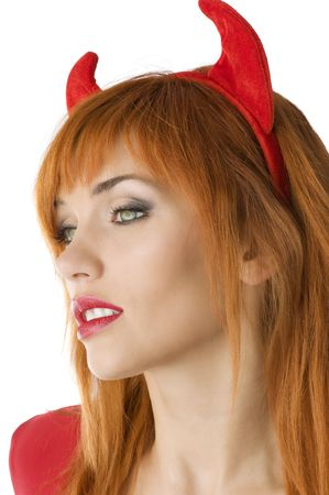 portrait of a red haired girl with horns like a devil looking away photo