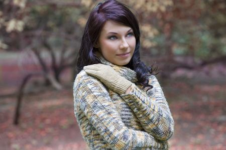 pretty young brunette in a forest in winter with a nice and sweet colored pullover Stock Photo - 5669744