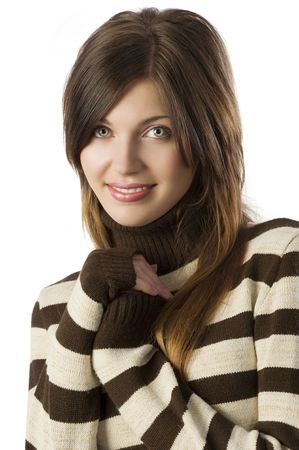 studio shot portrait of young cute and sweet brunette wearing a brown and white sweater photo
