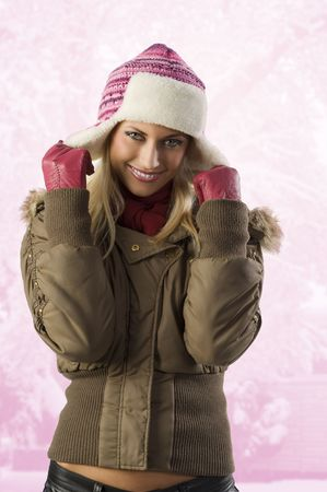 anorak: beautiful blond girl wearing a winter breakwind jacket scarf gloves and pink hat Stock Photo