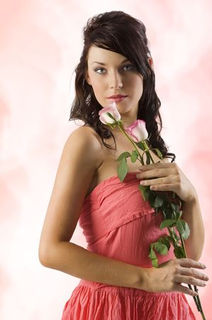 girl in red dress: young cute brunette with pink roses and wearing a pink dress