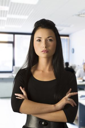graceful asian girl office worker in black dress with dark hair photo