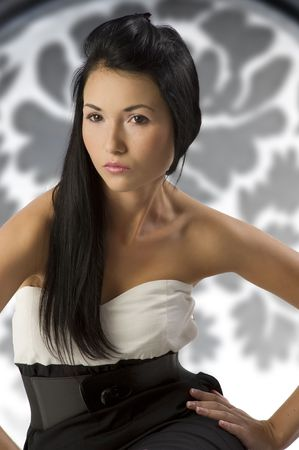 fashion shot of a cute asian woman on a stylish background