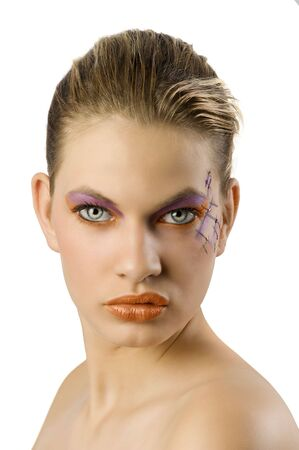 body paint: attractive blond girl with creative body paint make up on her face Stock Photo
