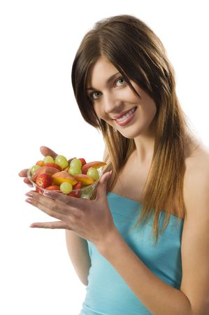 smiing: beautiful brunette smiing and looking in camera with a salad fruit