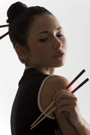 japanes: beautiful asian girl in japanes dress with chopstick in backlight Stock Photo