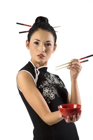 japanes: beautiful asian girl in japanes dress and chopstick showing a red cup