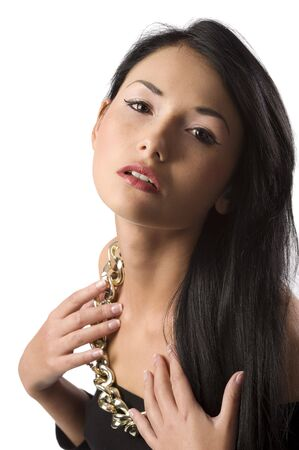 young pretty oriental woman with long black hair and a necklace in a fashion shot photo