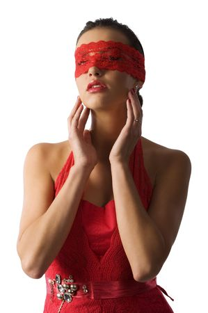 cute and sexy brunette in red shirt and a red lace mask looking up Stock Photo - 6260876