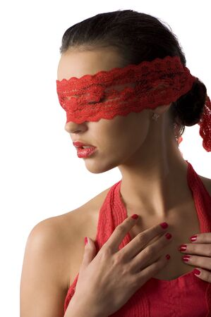 close up of a young cute brunette with a red lace mask looking down Stock Photo - 6260874