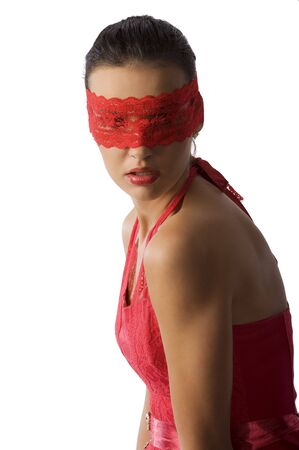 cute and sexy brunette in red shirt and a red lace mask looking up Stock Photo - 6260875