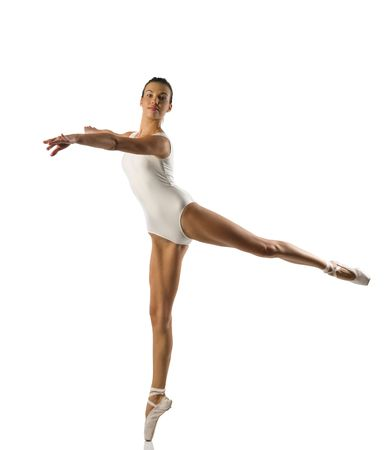pointe: Young caucasian brunette ballerina girl performing a dance on white background and white floor Stock Photo