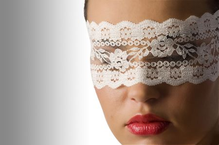 close up on the face of a cute young woman with red lips and white lace mask photo