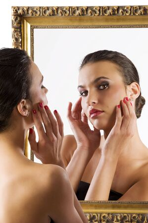 beauty portrait of young woman looking in camera from the mirror  photo