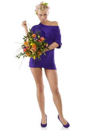 stunning blond girl wearing a violet short dress with flower on head and a bouquet as spring photo