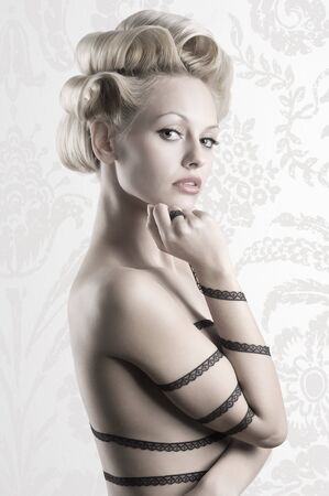 attractive blond girl with a fashion hair stylish and a strip lace around her naked body Stock Photo - 6553792