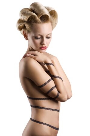 attractive blond girl with a fashion hair stylish and a strip lace around her naked body Stock Photo - 6553774