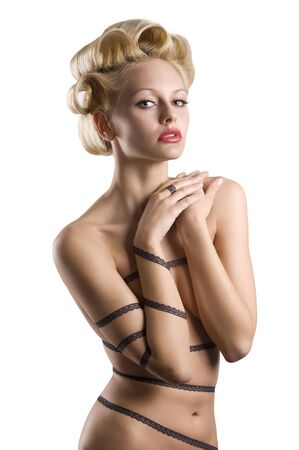 nice shot of a sensual blond girl with hair stylish and a string lace around her naked body Stock Photo - 6553777