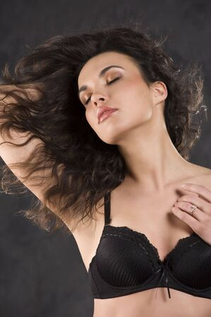 studio shot of a young, beautiful, sexy brunette woman in black lingerie on black background  Stock Photo - 6752488