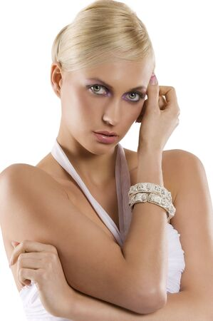 beautiful blond woman with bracelet jewellery and fashion make up isolated on white photo