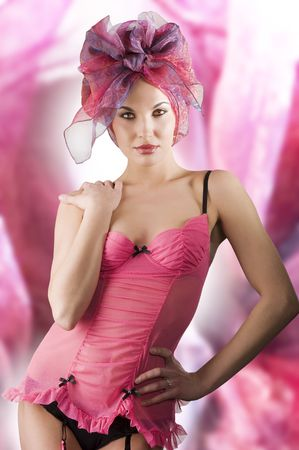 beautiful woman in pink lingerie with a colored headscarf looking like a brasilian girl photo