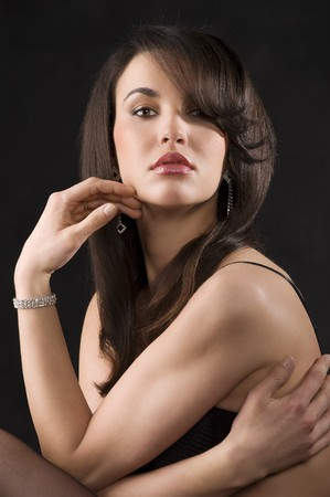 portrait of beautiful young brunette with nice hair stylish and make up Stock Photo - 6933326