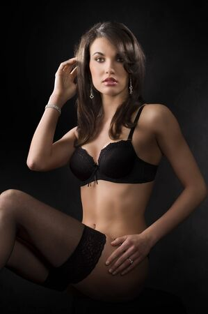 sensual beautiful young brunette in lingerie and black stocking with jewellery Stock Photo - 6933324