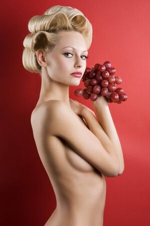 very cute and nude woman with hair stylish and a red grape looking in camera Stock Photo - 6933373