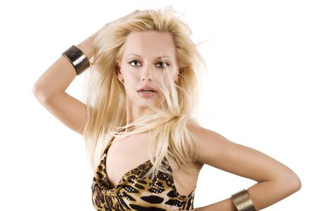 Blond young woman wearing a fashion dress playing with hair and wind on white background Stock Photo - 7012733