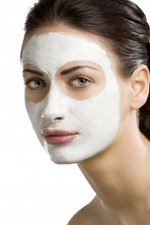 cosmetic cream: young woman getting beauty skin treatment on her face Stock Photo