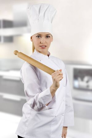 handled: young graceful woman dressed as a cook with cap over white backgound
