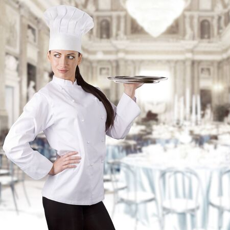 young graceful woman dressed as a cook with cap over white backgound photo