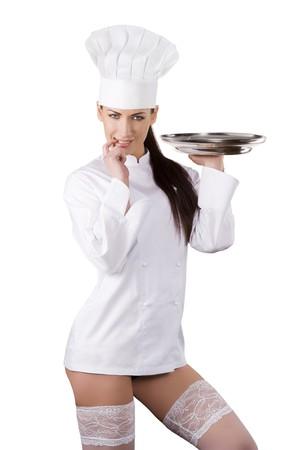 cocinero: joven mujer sexy vestido como un cocinero con gorra y mostrando sus piernas con medias blancas Foto de archivo