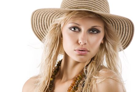 closeup portrait of pretty blond woman wearing a nice summer hat  photo
