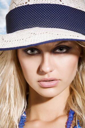 closeup portrait of pretty blond woman wearing a nice summer hat  Stock Photo - 7197506