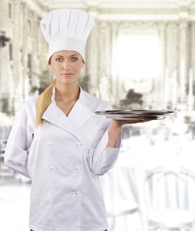 blond and young woman in white chef dress with hat photo
