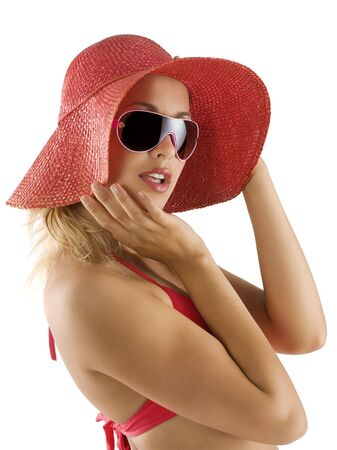 closeup portrait of pretty blond woman wearing a nice summer red hat and sunglasses photo
