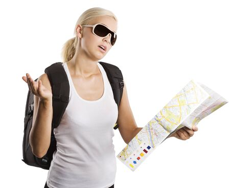 cute blond woman looking at a map and chatting by herself . isolated on white photo