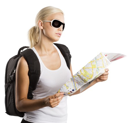 young blond girl with sunglasses looking at map isolated on white photo