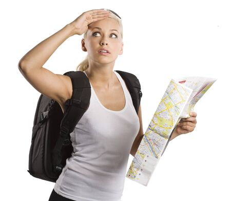 blond young woman carrying a backpack with map looking up  photo
