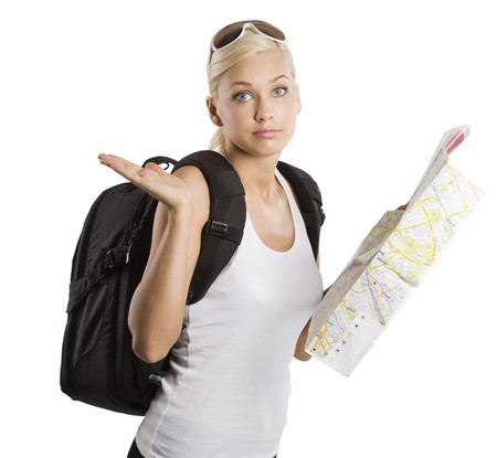 young pretty girl in vacation with map and rucksack looking in camera with funny expression Фото со стока