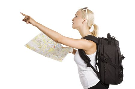 cute blond tourist girl with map and backpack point her finger at something photo