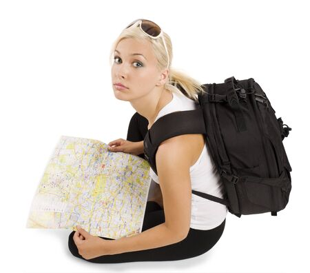 young pretty student girl in vacation with rucksack sitting and looking in camera photo