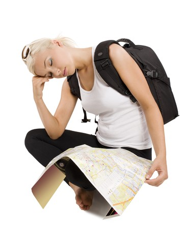 blond young tourist with map sitting down and sleeping  photo