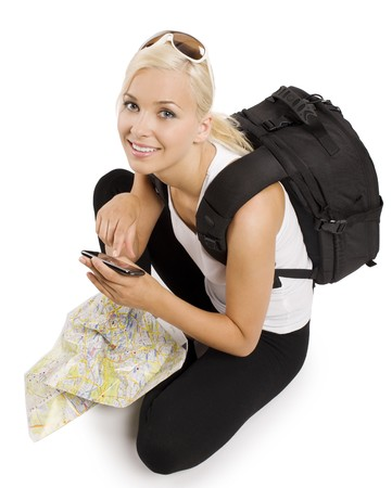 blond girl tourist with map sitting down and using a gps to find the right way